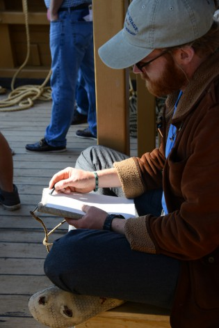 38th Voyager Matthew Ecklund works on a sketch on the CHARLES W. MORGAN on June 15, 2014.
