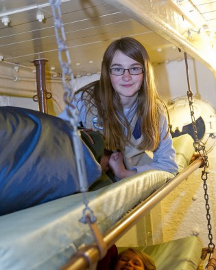 Scouts and youth groups experience the thrill of sleeping aboard a tall ship at Mystic Seaport's Anchor Watch program.
