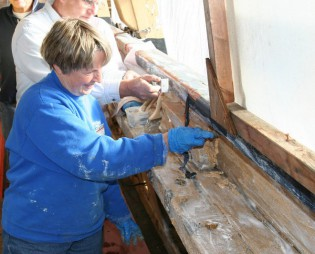 Anne Butler, the Museum's 2013 Volunteer of the Year, working on the CHARLES W. MORGAN restoration.