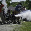 Civil War reenactors fire a cannon during a demonstration at Mystic Seaport. Mystic Seaport and the Connecticut Civil War Commemoration Commission will host one of the final Civil War encampments of the 150th anniversary July 18-19. More than 200 uniformed reenactors from several states will set up camp on the Museum's Village Green to carry out infantry drills, conduct artillery demonstrations, and engage in mock battle. File photo: Dennis Murphy/Mystic Seaport