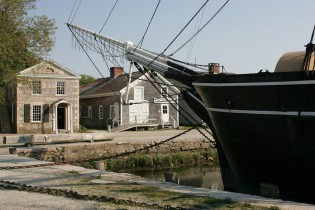 The Mystic Bank (left) and the Cooperage (right) behind the whaleship Charles W. Morgan at Chubb's Wharf.