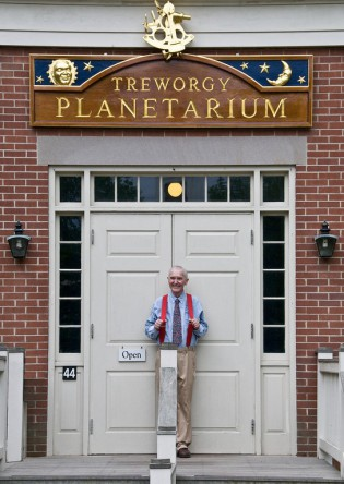 Longtime Planetarium Director, Don Treworgy, in his signature red suspenders outside of the Museum's planetarium that was named in his honor in May of 2009.