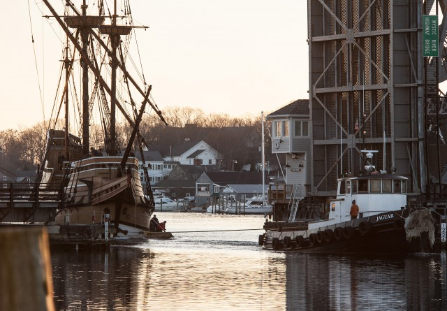 MAYFLOWER II passes through the highway bridge in downtown Mystic shortly before tying up at Mystic Seaport.