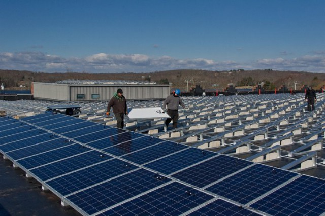 Installation of the solar panels on the roof of the Collections Research Center.