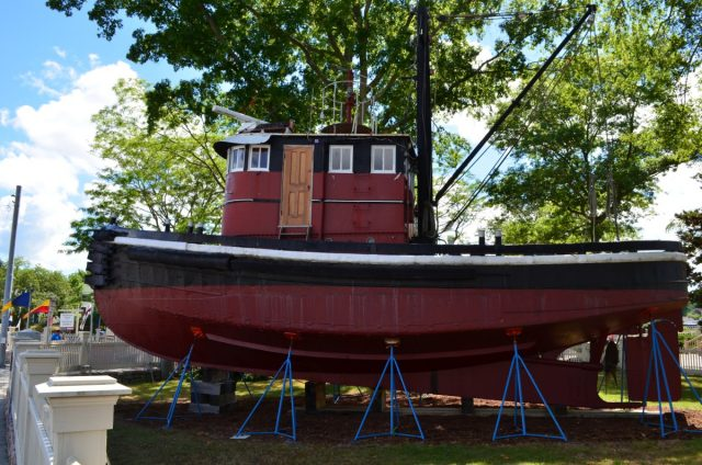 Tugboat KINGSTON II greets Mystic Seaport visitors at the Museum's main entrance.