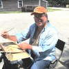 Maritime Gallery artist David Monteiro painting on grounds at Mystic Seaport