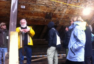 Mystic Seaport Shipyard Director Quentin Snediker (in yellow) discusses the Morgan project with scholars.