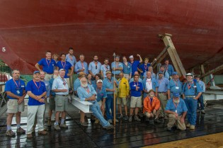Shipyard Director Quentin Snediker (leaning against the shiplift) and shipwrights who worked on the MORGAN restoration.