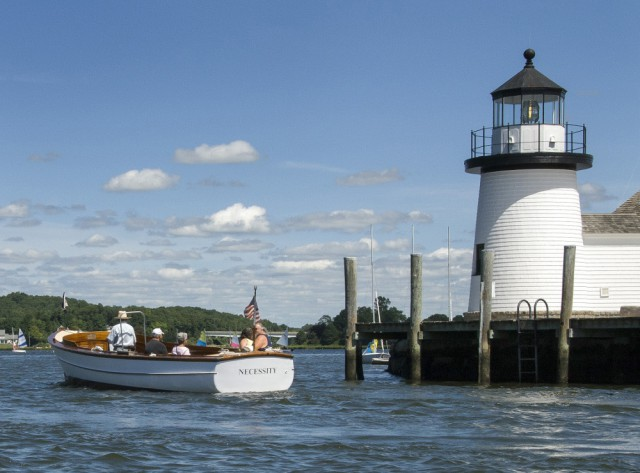 NECESSITY cruises past Lighthouse Point at Mystic Seaport.