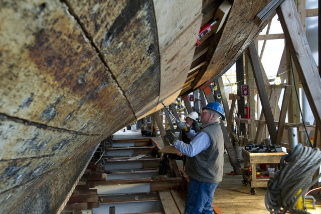 Shipwrights working on the CHARLES W. MORGAN restoration in the Henry B. duPont Preservation Shipyard at Mystic Seaport