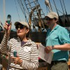 38th Voyager Lynn Barnes and Mystic Seaport staff member Erik Ingmundson take a wind measurement on the CHARLES W. MORGAN on June 15, 2014