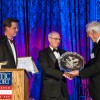The Museum's Board of Trustees Chairman Barclay Collins presents Nathaniel Philbrick with the 2015 America and the Sea Award on October 14, 2015. At the podium is Mystic Seaport President Steve White.