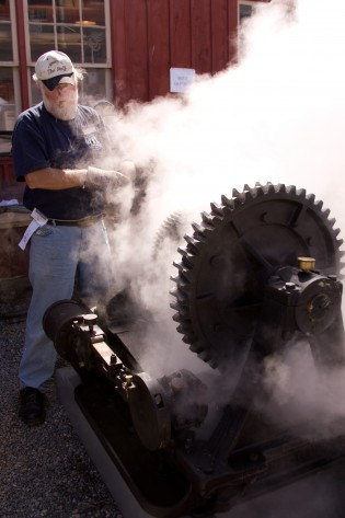 Rich Voss, volunteer for Mystic Seaport, operates a two-cylinder steam-powered Lingerwood Steering Engine at the Antique Marine Engine Exposition at Mystic Seaport. Photo Credit: Mystic Seaport
