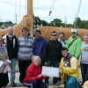 Students coming off a week of sail training aboard schooner Brilliant present Mystic Seaport with a gift of support.