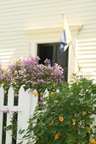Flowers bloom in front of the Buckingham Hall House