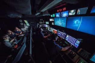 GFOE engineers and pilots fly deep-sea robots from the control room of a ship. (Photo credit: Global Foundation for Ocean Exploration)