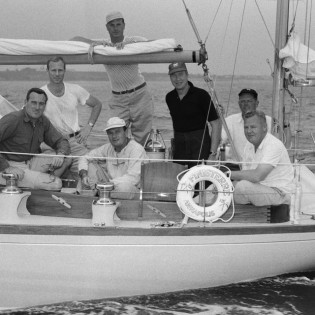 Crew of Finisterre, with Carleton Mitchell standing in dark shirt, 1956