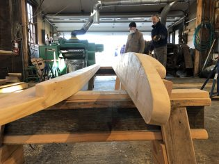 Museum volunteers RJ Lavallee and Bill Salancy review progress on the sledge they are making for Ice Festival. Photo: Elissa Bass/Mystic Seaport Museum