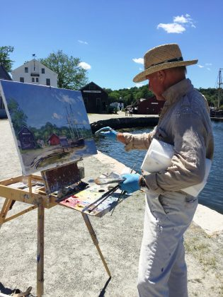 Artist Jan Pawlowski paints en plein air at Mystic Seaport in 2016. Mr. Pawlowski will be participating in the 2017 exhibition and show. Photo credit: Mystic Seaport