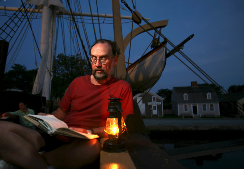 "Reading ""Moby-Dick"" aboard the whaleship CHARLES W. MORGAN. File photo. Credit: Mystic Seaport"