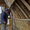 Museum shipwrights working on the Charles W. Morgan's hull. March 2, 2012. Photo Credit: Mystic Seaport/Dennis A. Murphy