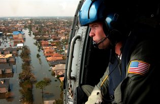 Image of USCG helicopter over New Orleans